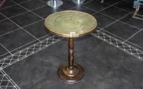 A Brass Topped Side Table fitted on a Beechwood turned base. Measures 18 by 24 inches.