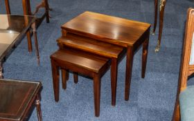 Nest of Three Tables, raised on four legs, largest 23'' width x 15'' depth x 20'' height.