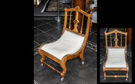 A Victorian Mahogany Nursing Chair of shaped scroll form with Ebony and Satinwood geometric inlay,