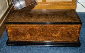 A Large Oversized Music Cylinder Box Carcus hinged top with brass carry handles with walnut veneer
