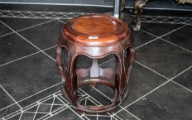 Chinese Rosewood Barrel Shaped Stool with five encased, bowed legs,