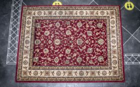 Traditional Wool Rug, in burgundy colour with cream and gold borders, in good condition.