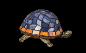 Tiffany Style Table Lamp in the Form of a Tortoise. Shade in blue and coral coloured glass.