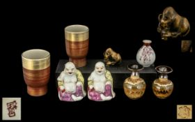 A Miscellaneous Collection of Oriental Items to include a Famille Rose Buddha, two pairs of vases,
