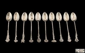 Italian Mid 20th Century Fine Set of Ten Silver Teaspoons Each with Flower Tops and Sinuous Stems.