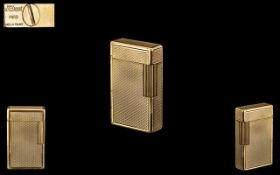 S. T. Dupont, Paris, Stylish Quality Diamond Pattern Gold Plated Lighter. From the 1960s.