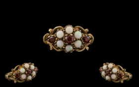 Ladies - Attractive 9ct Gold Opal and Garnet Set Dress Ring - Flower head Design.