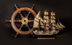 A Reproduction Ship's Wooden Wheel with a brass centre. Measuring 23 inches in diameter. Together