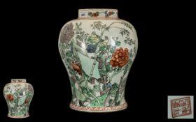 Chinese Famille Verte Decorated Baluster Shape Vase depicting birds amongst foliage; red character