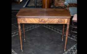 A 19thC Mahogany Tilt Top Tea Table turned and fluted supports and brass castors.
