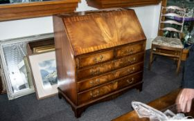 A Georgian Style Mahogany Bureau the fall front with green tooled leather top,