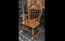 Child's Wooden Rocking Chair.