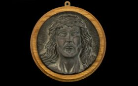 A Bronze Roundel Cast with the Head of Christ with thorns. 7 inches in diameter.