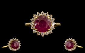 Ruby and White Topaz Halo Ring. A Round