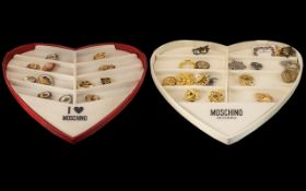 2 Moschino Heart Shaped Display Cases & A Collection of 30 Scarf Clips.