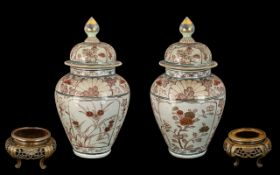 Pair of 18th Century Japanese Imari Lidded Vases of typical form and decoration,