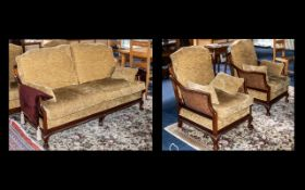 A 20thC Bergere Suite in the Georgian Style mahogany framed with gadrooned edge and ball and claw