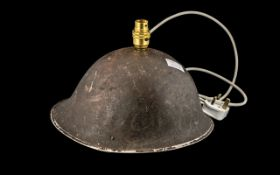 WWll Military Helmet, drilled for a lamp base; 12 inches (30cms) wide x 9.5 inches (ap.23cms) high