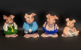 Collection of Four Wade Piggy Banks comprising Mummy Pig, Daddy Pig, School girl, and Baby Pig.