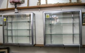 Chrome & Glass Display Cabinet with three moveable glass shelves and lighting,