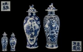Two Antique Chinese Blue and White Lidded Vases, decorated to the body with birds and flowers,