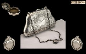 A Silver Opera Purse with adjustable chain and handle, Of typical form and engraved front.