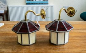 Two Glass Leaded Wall Lamps in lantern shape, in cream and ruby glass of the Art Deco style.
