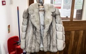 Ladies Silver Fox Fur Jacket, hip length, full length sleeves, two slit pockets.