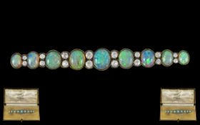 Antique Period Superb Quality Platinum Opal and Diamond Set Long Brooch of Graduated Form,