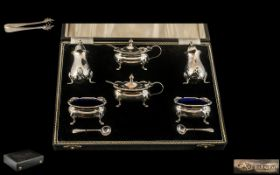 A Fine Quality Sterling Silver 6 Piece Cruet Set Complete with Spoons and Blue Liners + A Pair of