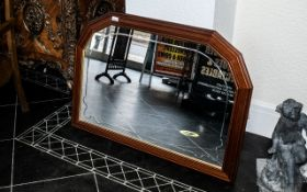 """A Modern Arched Wall Mirror, mahogany finished frame, 29"""" x 42""""."""