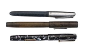 Three Vintage Fountain Pens comprising a Blackbird marble-effect self-filling pen with 14k nib;