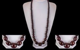Early 20th Century Cherry Amber Long Graduated Bead Necklace of Excellent Quality. c.1920's.