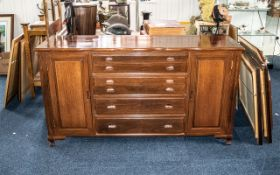 A Teak Modern Mahogany Sideboard with 4 fitted drawers containing a canteen of cutlery above two