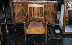 A Mahogany Commode with fitted pan and cushioned hinged seat.