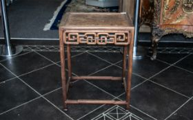 Chinese Antique Hardwood Side Table with a burr root top, intricate carved interlacing frieze design
