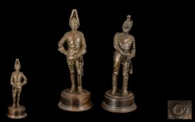 Pair of Bronzed Finish Resin Soldiers - 'Dragoon' and 'Coldstream Guard', both in full uniform and