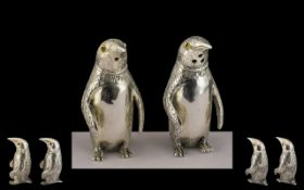 A Pair of Silver Novelty Salt and Pepper Pots In the Form of Penguins. Marked 800 Silver.
