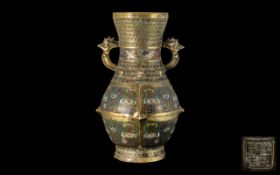 Antique Chinese Bronze Vase in the archaic style, with chicken head handles,