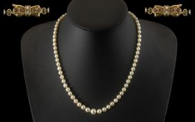 Ladies - Good Quality Graduated Single Strand Cultured Pearl Necklace with 9ct Gold Stone Set Clasp.