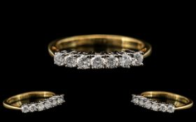 18ct Gold - Attractive Seven Stone Diamond Set Dress Ring. Fully Hallmarked for 750 - 18ct.