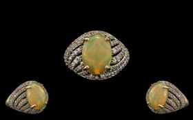 Ladies - Attractive and Pleasing 9ct Gold Opal and Diamond Set Dress Ring. Full Hallmark for 9.375.