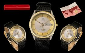 Omega - Seamaster Gents Steel and Gold Quartz Day-Date Cal 1425 Wrist Watch with Leather Strap. c.