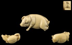 Japanese Meiji Period Carved Ivory Figure of a Pig, fully signed by the artist; originally of the