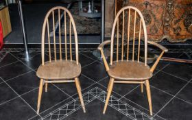Pair of Ercol Blonde Spindle Back Chairs, with tapered legs and cross stretcher, one with arms.