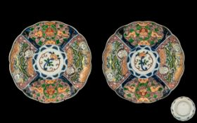 Pair of Antique Imari Dishes of Lobed Shape decorated to the panels with floral and bird designs.
