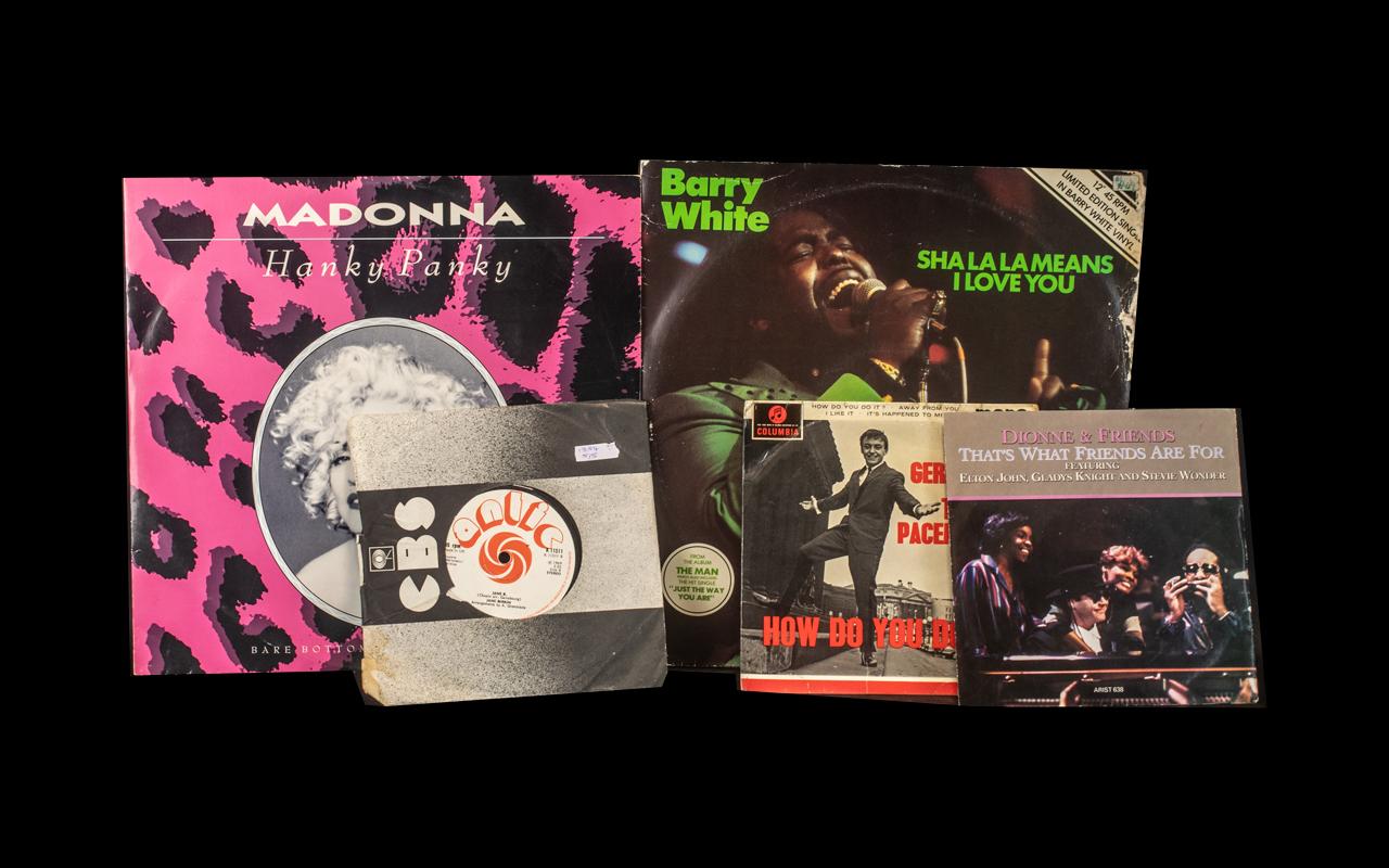Barry White 12'' 'Sha La La Means I Love You' and Madonna 12'' 'Hanky Panky', along with Gerry & The