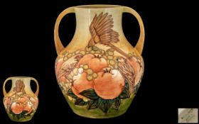 Moorcroft Large and Impressive Twin Handled Tubelined 'Fruits and Finches' Vase, with ochre