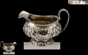 Georgian Period - Sterling Silver Embossed Cream Jug. Hallmark London 1822, Maker William Hewitt.