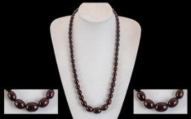 A Superb Early 20th Century Long & Well Matched Cherry Amber Beaded Necklace of excellent colour
